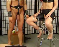 Brown-haired milf acquires her hairless wet crack toyed in FFM BDSM movie