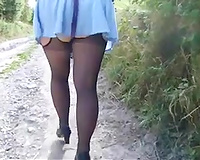 My chubby slutwife in nylons and miniskirt walks on a suburb road
