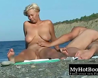My voluptuous slutwife is engulfing my love tool on the beach