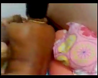 Amateur black haired Indian wifey lets her hubby spoon her on ottoman