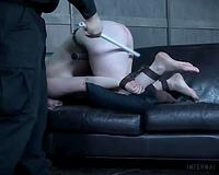 Chubby pale skin slut was restrained and manacled on the sofa