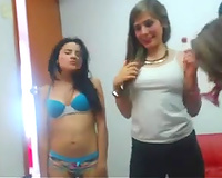 Four breathtaking dark brown gals disrobe and play with their constricted breasts