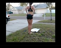 Naughty chick head stand in the front yard all nude