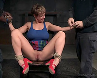 Busty golden-haired white bimbo bound up and gagged in her garments