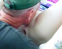 Fingering and licking salty soaked snatch in the park