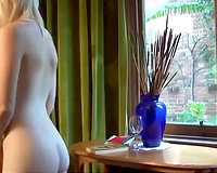 Petite golden-haired girlfriend with smooth silky body bare on web camera