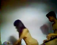 Dark haired skinny Desi pair bonks doggy and in cowgirl pose