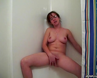 Chubby and exceedingly concupiscent hottie with glasses rubs her cum-hole in washroom