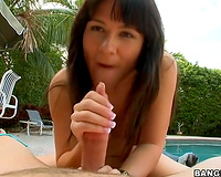 Beautiful dark brown by the pool is very gentle and soft with the large pantyhose dick