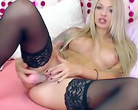 Blond haired breathtaking web web camera nympho in stockings masturbated her love tunnel