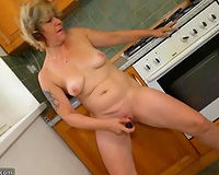 Mature white blond cheating wife in the kitchen masturbating