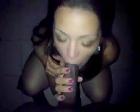 Greedy for cum wench blows giant dark penis and her eyes closed with fun