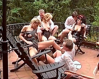 Blonde European sluts on the patio with a bunch of dudes