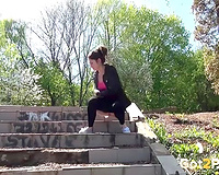 Bootyful sporty brunette girlie crouches and urinates on the stairs