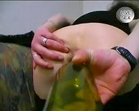 Insane dark brown older slut masturbates with bottle