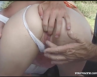 Amateur cutie demonstrates her cock-sucking skills in a car