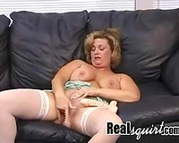 Trashy nympho in white nylons just can't live without masturbating on the couch