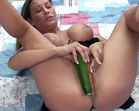 Hot milf stuffs her wet crack with squash on the floor on camera