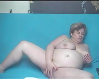 Huge boobed granny playing with her pussy in solo video