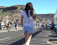 Beautiful dark brown white hotwife pissing at the parking lot