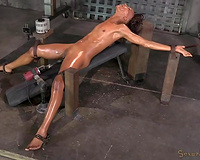 Almost crucified titless dark slut is strapped and mouthfucked hard