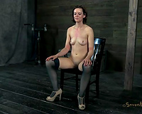 Hogtied redhead in heels lies on wooden box and receives throat group-fucked
