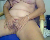 Mature and fat slutwife masturbating and stretching on webcam