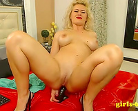 Blonde mature whore drills her love holes with her chocolate fake penis on web camera