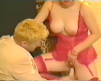 Curvaceous dark brown breasty woman toyed with a large fake penis