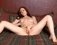 Classy dark brown temptress can't live without playing with her pleasing pink slit