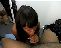 Kinky ebon playgirl with large natural milk sacks gives excellent oral pleasure in the office