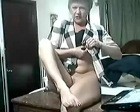 Webcam solo with sexually excited granny showing her body and dressing up