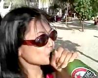 Drunk brunette hair whore rubs her cunny sitting on thr bench