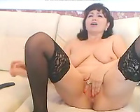 Emotional black haired cam housewife in stockings masturbated with toy