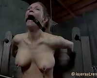 Sexy golden-haired bitch with big love melons restrained by her brutal mentor