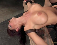 Elegant and breasty milf hottie shackled and handling 2 guys