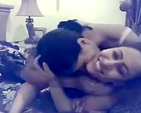 Two Arab buxom lesbos are giving a kiss and spooning every other with passion
