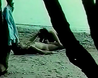 Hairy fellow fucking a breasty brunette hair wench on the beach