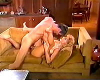 Busty and lusty golden-haired bimbo on the bed blows jock