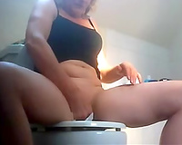 Hidden webcam clip with my housewife rubbing her clit in the shitter