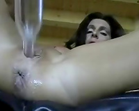 A concupiscent dark brown milf bonks her coochie with a glass bottle