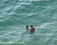 Sweet girlfriend and her guy were sunbathing nude on the beach