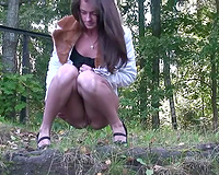 Gorgeous real Russian dark brown teen in the woods urinates off the cliff