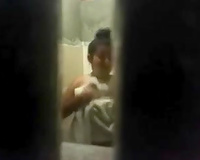 Spy livecam clip of quite skinny brunette taking a shower and drying herself