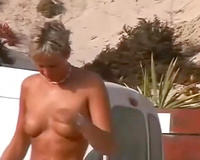 Spying on non-professional mother I'd like to fuck sunbathing exposed on a beach