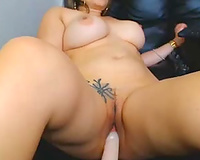 Tattooed all concupiscent cam fatso with large boobies was riding her sex tool