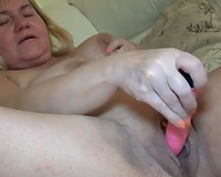 Big breasted granny bonks her twat with her beloved sex toy