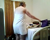 Hidden livecam catches mature aunty changing after taking shower