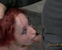 Redhead skanky doxy fixed in doggy style position in BDSM barn