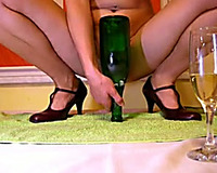 Huge green glass bottle was inserted in lusty nympho's muff unfathomable